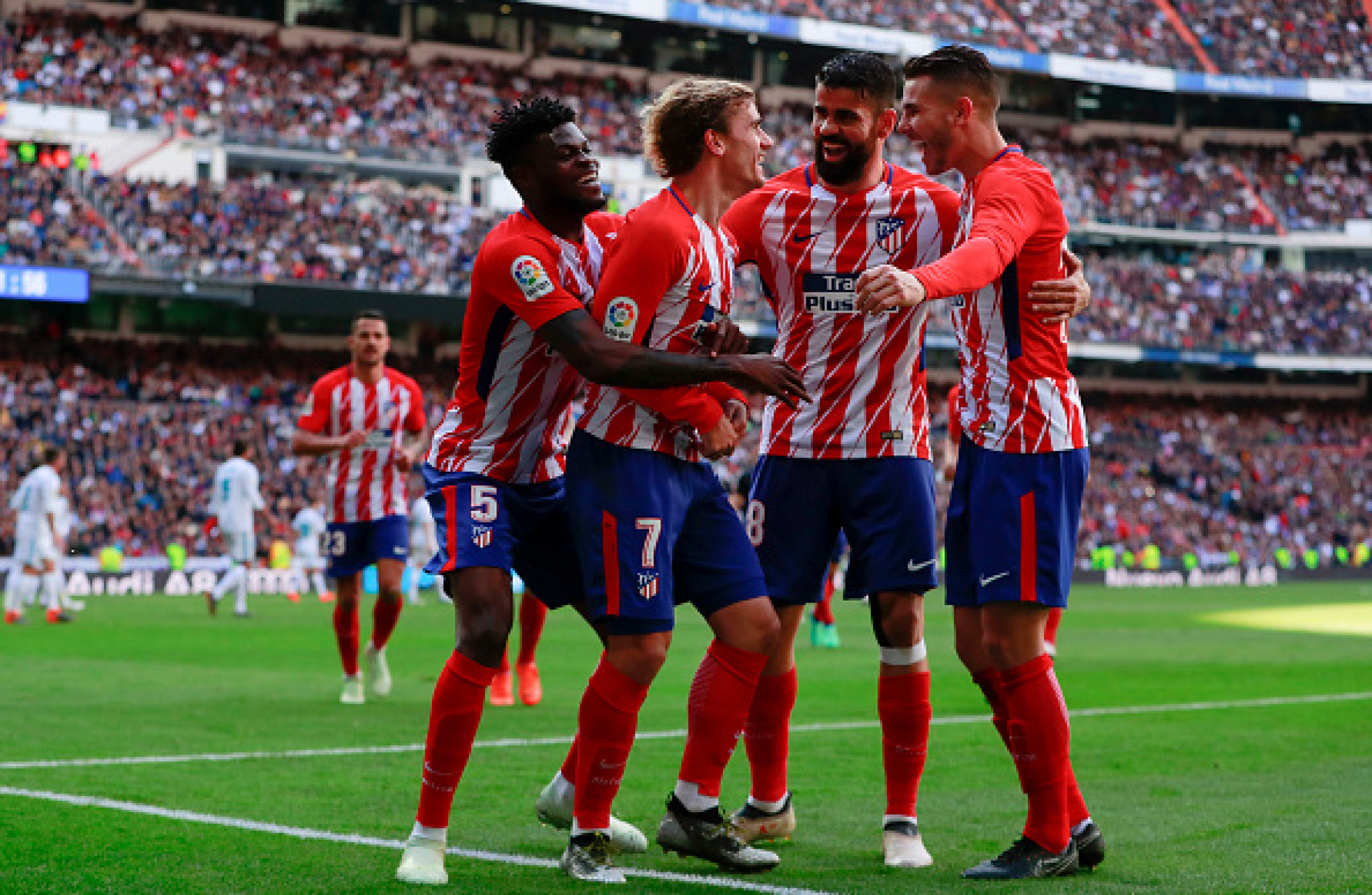 Atletico Madrid's Diego Simeone hails Antoine Griezmann after derbi leveller