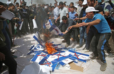 Tear gas and black smoke: Protesters are burning Israeli flags in Gaza
