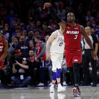 Wade rolls back the years as Miami snap Philadelphia's 17-game winning streak