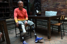 Double leg amputee reaches summit of Everest, 40 years after losing his feet during his first attempt