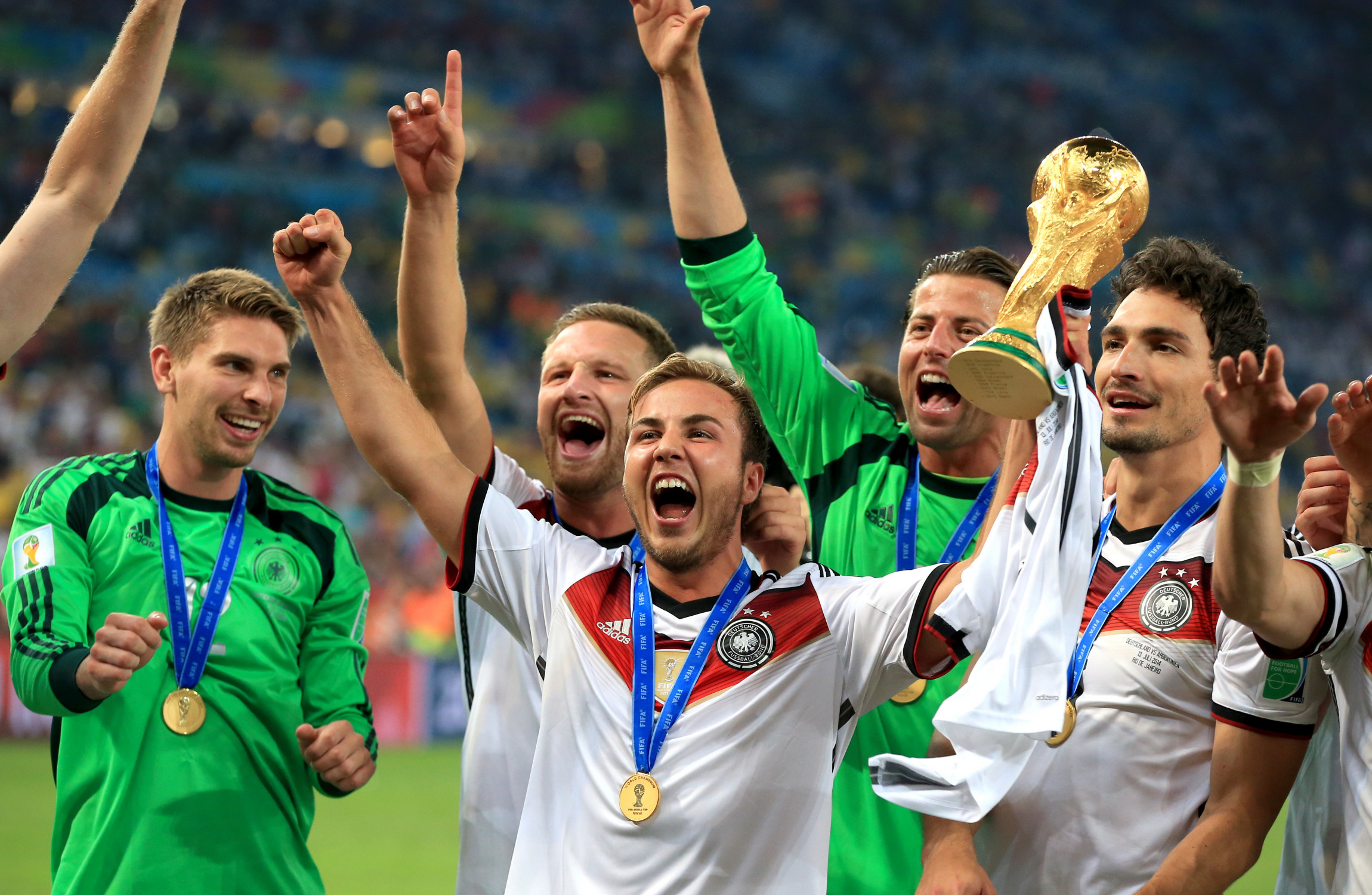 Gotze lifts the World Cup trophy alongside German team-mates four years ago.                     Image Nick Potts