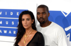 Kim Kardashian ate the head off a songwriter on Twitter after he came for Kanye West