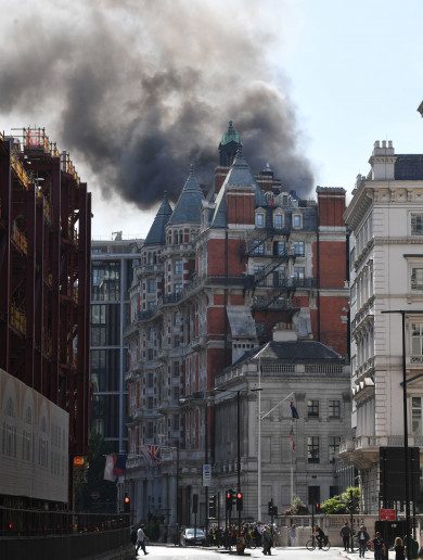 A huge fire has broken out on the roof of a hotel in central London
