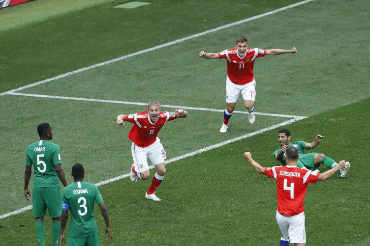Russia's Iury Gazinsky (C) celebrates his first goal during the opening match of the 2018 Fifa World Cup in Moscow.