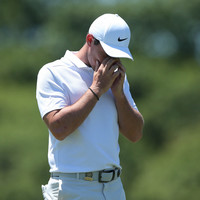 Johnson shares lead as McIlroy blows up in face of US Open test at Shinnecock