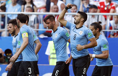 Uruguay top Group A as Suarez and Cavani fire them to victory over 10-man Russia