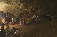 Rescuers battle heavy rain as search continues for 12 children trapped in cave in Thailand