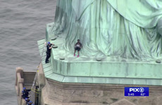 Woman arrested after scaling Statue of Liberty to protest US immigration policy