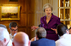 After a day-long private meeting, Theresa May's cabinet agrees to a 12-point Brexit position