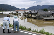 Death toll rises to at least 57 as torrential downpours devastate Japan