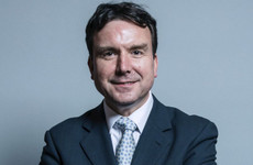 British minister resigns over lewd messages to women