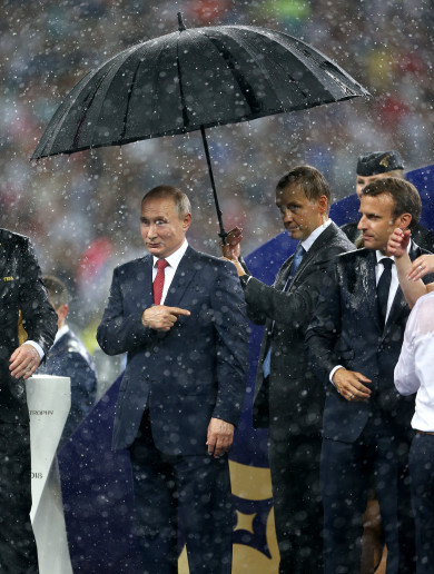 'In Mother Russia only Putin gets an umbrella' - Viewers bemused by President's World Cup 'power move'