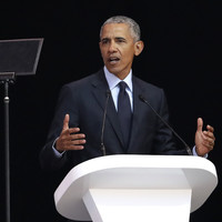 Obama warns of 'strange and uncertain times' during tribute to Nelson Mandela