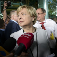 Poland's 'retired' top judge back at work as government tries to oust her