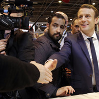 Macron fires aide seen hitting protester while dressed as riot policeman