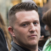 Tommy Robinson supporters chant his name as he's freed from prison