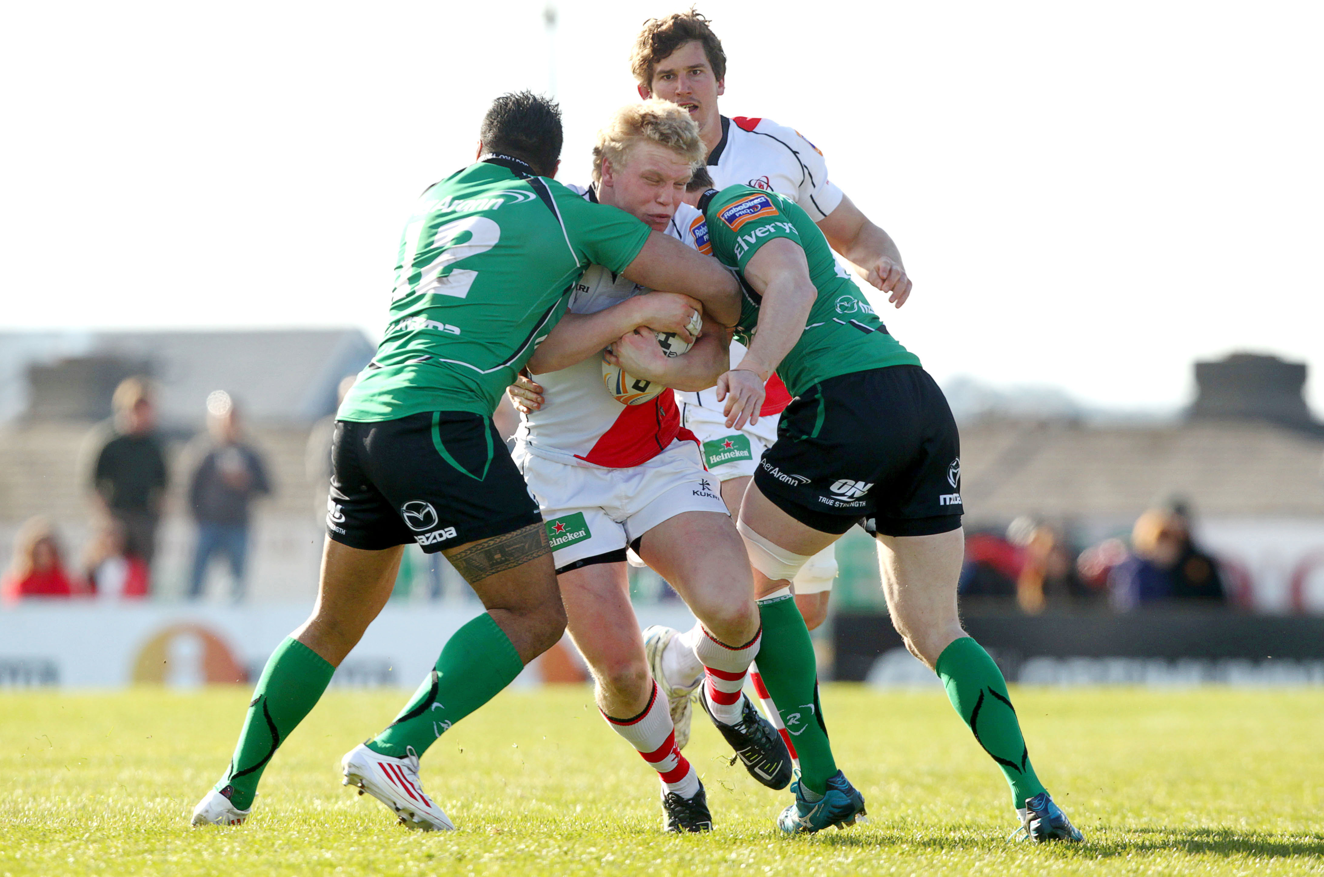 Nevin Spence is tackled by Henry Fa'afili and Kyle Tonetti