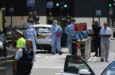 London terror suspect remains in custody as UK police search three homes