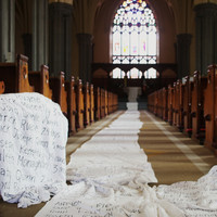 Names of 796 Tuam Babies written on white sheets and brought to Galway church