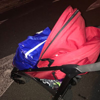 Mother and one-year-old child walk streets waiting to hear about accommodation for the night