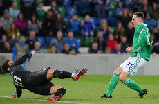 Northern Ireland striker scores with his first touch in international football