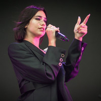 Dua Lipa cried on stage in Shanghai after young fans waving rainbow flags were dragged from the venue by security