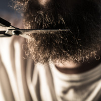 A retail worker got a �2,500 payout after claims he was subjected to a 'beard vendetta'