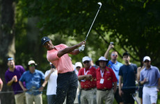 Tiger Woods seizes share of lead at Tour Championship, Rory McIlroy in the hunt