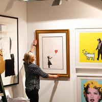 Banksy artwork self-destructs after selling for �1.2 million at London auction