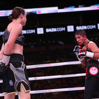 Taylor toys with tough Cindy Serrano to retain titles in Boston as a 'Notorious' fan watches on