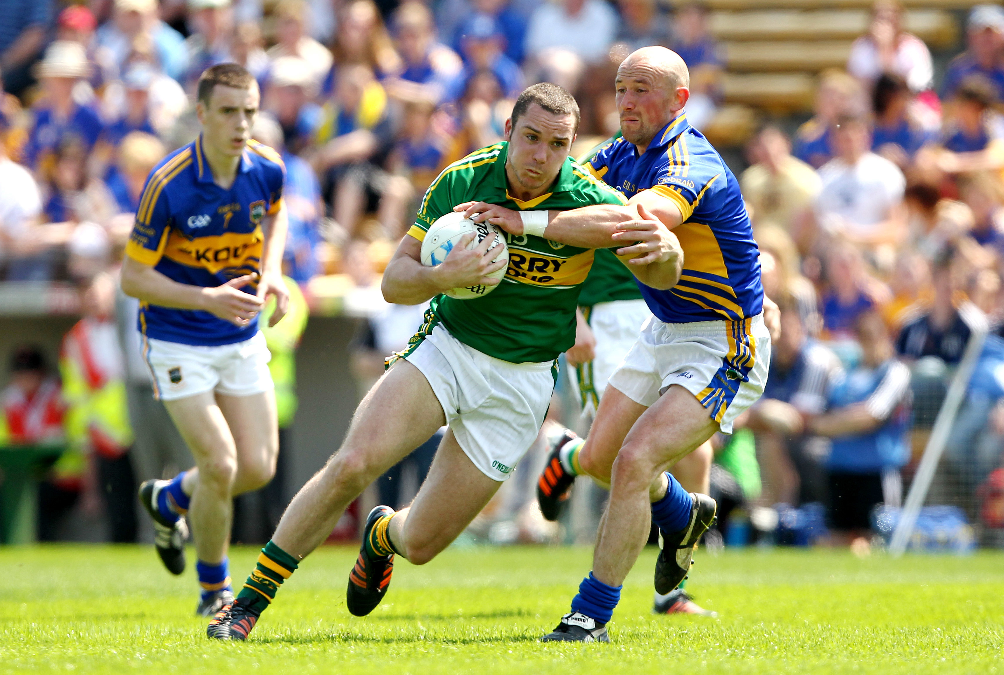 Kerry's Patrick Curtin and Andrew Morrissey of Tipperary.