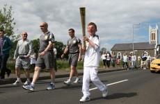 Olympic torch spotlights Northern Ireland coast