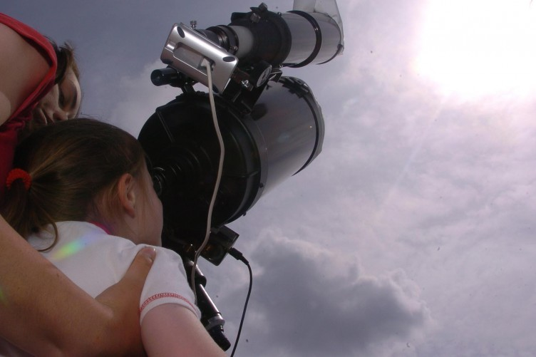 June 2004: Christine Keogh, 13, from Dublin, helps her sister Kate look through a telescope to see the planet Venus passing across the Sun's face.