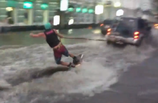 VIDEO: Man uses floods to surf down the street