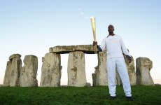 Games legend lights up Stonehenge with Olympic torch visit
