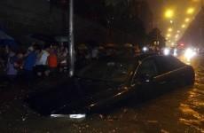 Ten die in record rains in Beijing