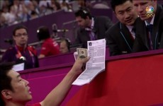 Wait a minute: Why was that Japanese coach handing a wad of $100 bills to a gymnastics judge?