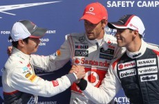 Button claims his first pole for McLaren in Belgium