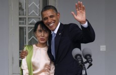 Obama visits Aung San Suu Kyi at home, calls for more reform