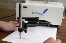 Obama signs 'fiscal cliff' deal into law (with an autopen)