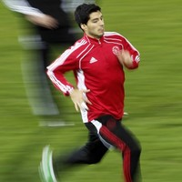 On his way: Liverpool agree �26.5million Suarez transfer