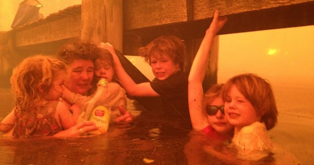 PICS: Family jumps in sea to shelter from raging wildfires