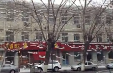Wowsers! Look at this snow falling off the roof