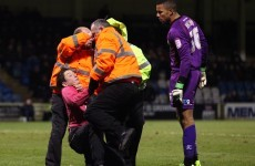 Another idiotic fan shoved a goalkeeper to the ground in League Two tonight