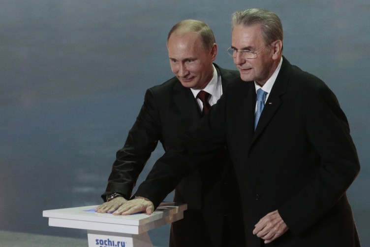 Russian President Vladimir Putin, left, and IOC President Jaques Rogge press a symbolic button to mark one year to the start of the 2014 Winter Olympics, in Sochi, Russia.