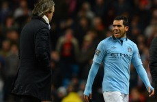 Drive on: Carlos Tevez staying at Man City, insists Roberto Mancini