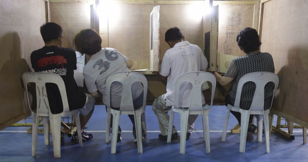 Pics: Filipino voters hit the polls in vital elections of over 18,000 politicians