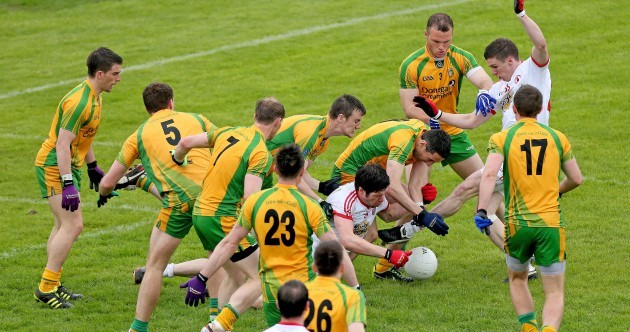 Tyrone's Sean Cavanagh surrounded by 9 Donegal players