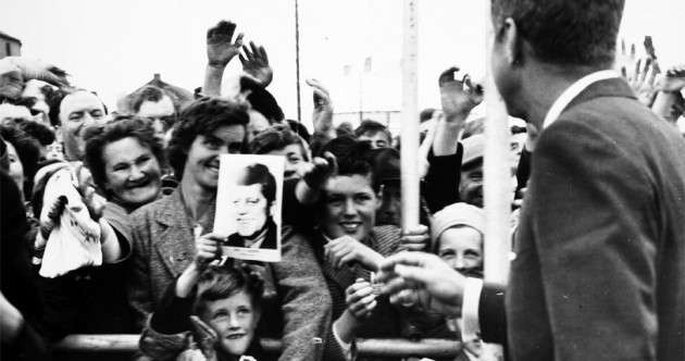 We found the boy smiling up at JFK during his visit to Ireland in 1963