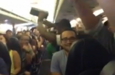 Passengers stuck on overheated plane take dramatic action